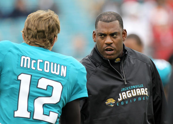 Mel Tucker shakes hands with Luke McCown before a Jaguars game last season. (Sam Greenwood/Getty photo)