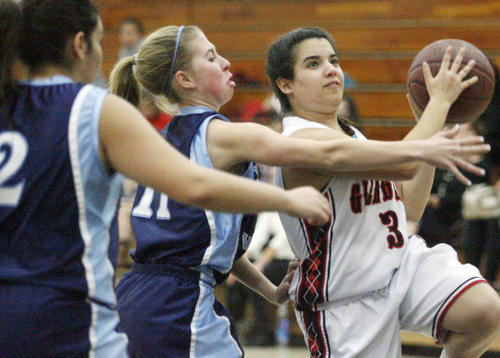 Glendale's Amanda Mazanians, right, goes for a shot while CV's Jacqueline Wilson defends Mazanians during a game at Glendale High School l in Glendale on Tuesday, January 22, 2013.
