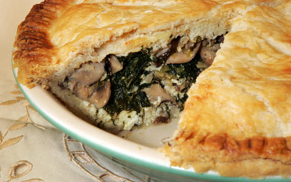 "Wild mushrooms, spinach and cheese combine in a pie so rich and filling you might never guess it's vegetarian. <a href=""http://www.latimes.com/features/food/la-fo-savorypiesrec13c-2010jan13,0,5159089.story"">Click here for the recipe.</a>"