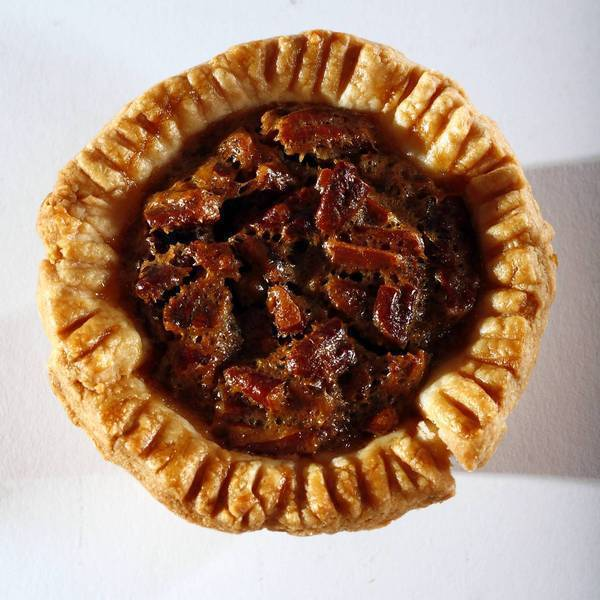 "Classic pecan pie is miniaturized in this recipe. <a href=""http://www.latimes.com/features/food/la-fo-mini-pies-rec3-20121117,0,5255527.story"">Click here for the recipe.</a>"