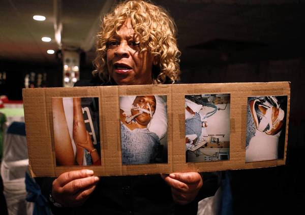 In December 2011, Gloria Carr holds photos of her son Darrin Hanna, who died that Nov. 13, after a confrontation with North Chicago police.