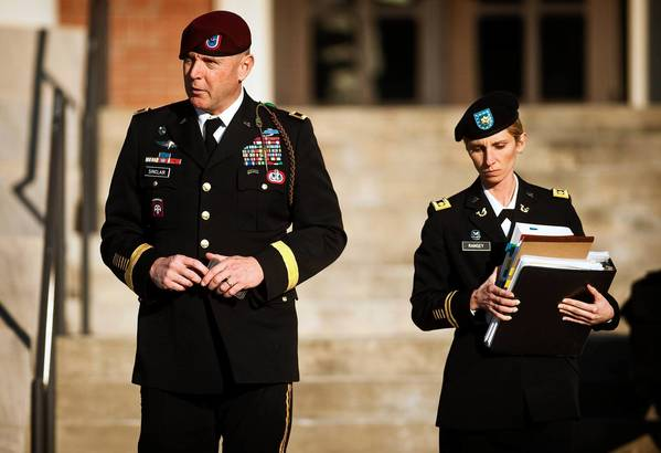 Army Brig. Gen. Jeffrey A. Sinclair leaves a Ft. Bragg, N.C., courthouse with a member of his defense team.