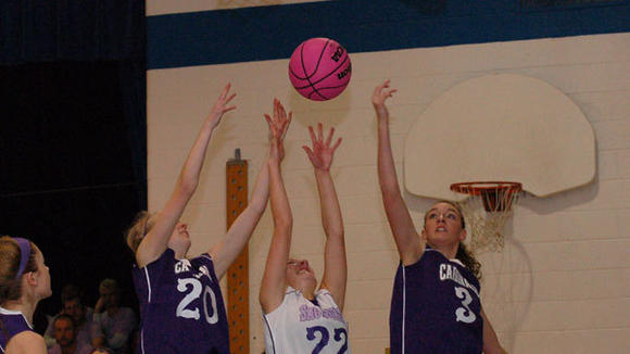 J-L's McKenzie Mathewson (20) and Haley Weaver (3) battle with Christina Smith of St. Mary for a rebound.
