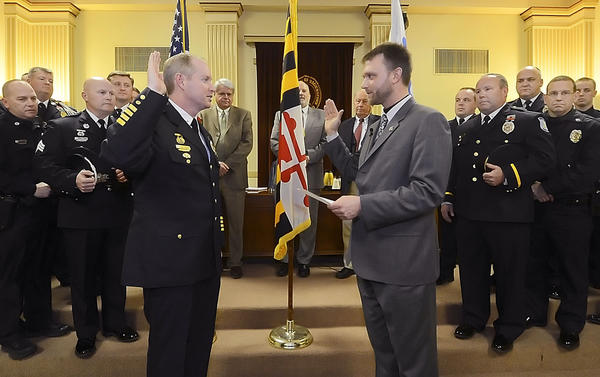 Hagerstown City Police Chief Mark Holtzman, left, is sworn in by Hagerstown Mayor David S. Gysberts Tuesday evening in the city council chambers.