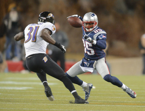 Ravens safety Bernard Pollard chases down Patriots wide receiver Brandon Lloyd in the AFC title game.