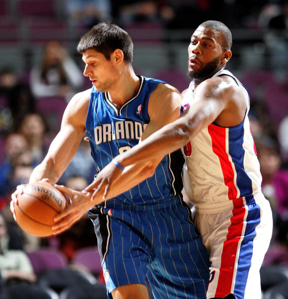 The Detroit Pistons' Greg Monroe, right, defends against the Orlando Magic's Nikola Vucevic during first-period action at The Palace of Auburn Hill