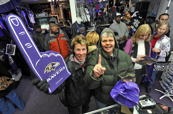 Ravens fans, Mary Cupo of Parkville, left, and Mary Sue Bride of Glen Arm, right stock up on fresh Ravens merchandise. The Ravens Zone store has been doing a brisk business especially since the Ravens win over the Patriots last Sunday means they are headed to the Super Bowl.