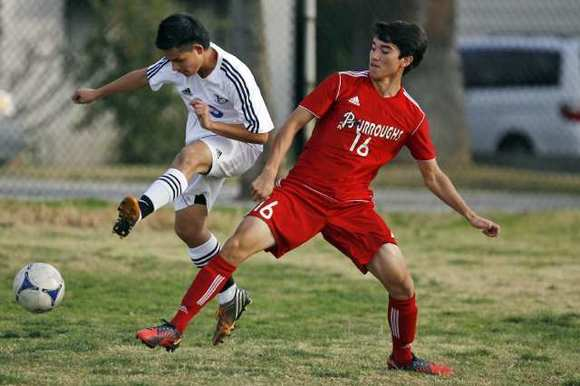 Hoover's Carlos Morataya, left, and Burroughs' VJ Salazar fight for the ball during Tuesday's game.
