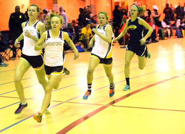 Hereford's Erin Causey, Sarah Ashwood and Meghan Anderson run ahead of Catonsville's Claudia Flister in teh 1600 meter run.
