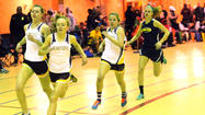 The Baltimore County indoor track and field championships turned into the Hereford classic as the Hereford boys and girls captured both titles at the Fifth Regiment Armory on Tuesday.