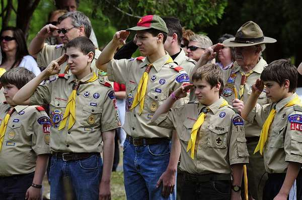 Members of the Boy Scouts salute during the raising of the flag in this May 25, 2009 file photos at the Willow River Cemetery in Hudson, Wis., during Memorial Day ceremonies.