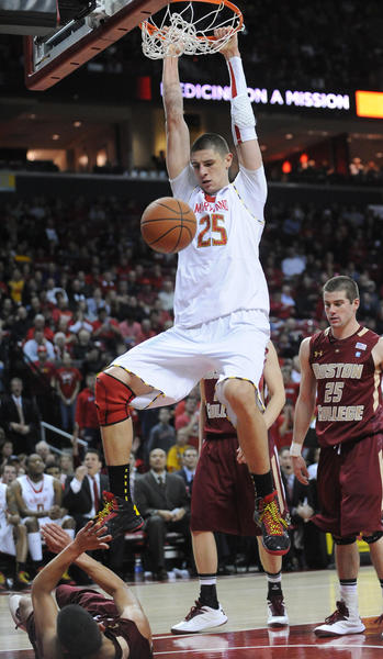 Maryland's Alex Len completes the dunk on Boston College's Lonnie Jackson.