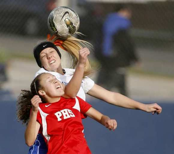 Burbank High's  Maddie Carlborg battles for the ball vs. Pasadena High's Alise Hildreth.