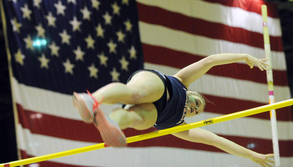 Franklin sophomore Olivia Gruber soars over the bar on her way to winning the pole vault. She also won the high jump for the second-place Indians at the Baltimore County track championships.