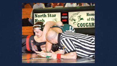 North Star's Thomas Miller pins Meyersdale's Austin Imler in the meet-clinching victory for the Cougars at 182 pounds on Tuesday night. Also pictured is referee Brandon Boburchock.