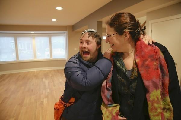Jacob Mosbacher, 25, is excited to show his mom, Joan Katz, his new home last month as he and other clients of the Libenu home check out the special-needs house in Chicago's West Rogers Park.