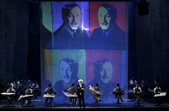 "In the course of ""The Perfect American,"" artist Andy Warhol, portrayed by John Easterlin, center, visits Walt Disney to express admiration for Disney's work. The opera, with music by Philip Glass, continues through Feb. 6 at Teatro Real in Madrid."