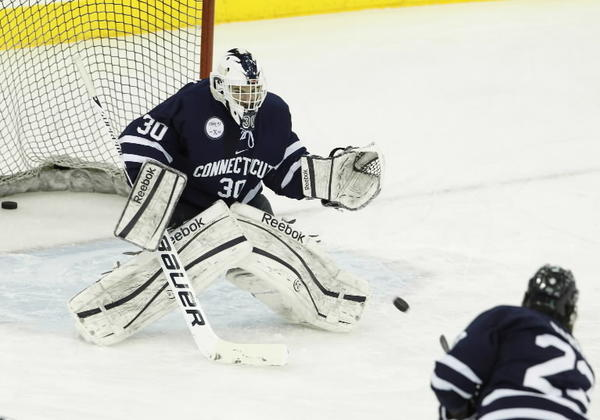 Connecticut Huskies goaltender Matt Grogan (30) warm up before the start of the game against the Quinnipiac Bobcats at the TD Bank Sports Center.
