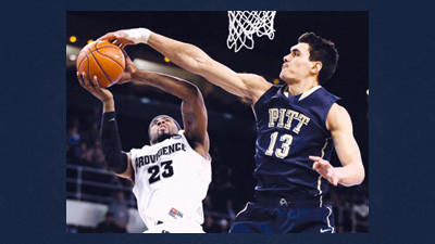 Pittsburgh center Steven Adams (13) blocks a shot by Providence forward LaDontae Henton (23) during the first half of an NCAA college basketball game in Providence, R.I., Tuesday.