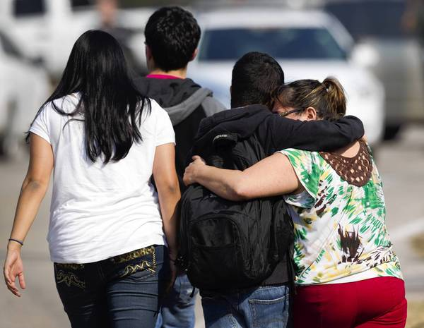 People leave Lone Star College-North Harris in Houston after a shooting sent students fleeing for safety.
