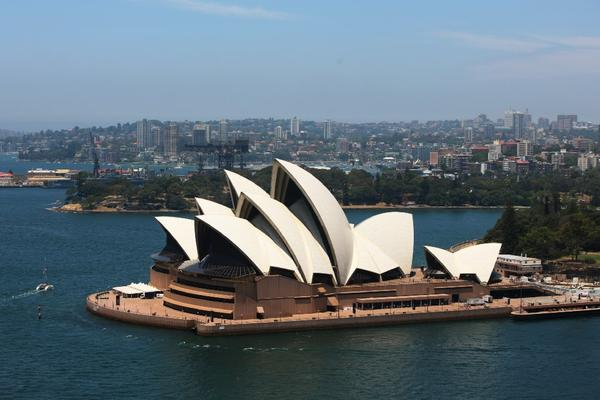 A view of the Sydney Opera House from the arch of the Sydney Harbour Bridge.