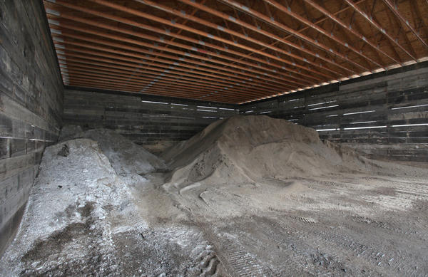 A pile of salt, far left sits next to a pile of salt and sand mixture in a storage shed at the Brown County Highway Department Shop on Eighth Avenue Northeast. American News Photo by John Davis