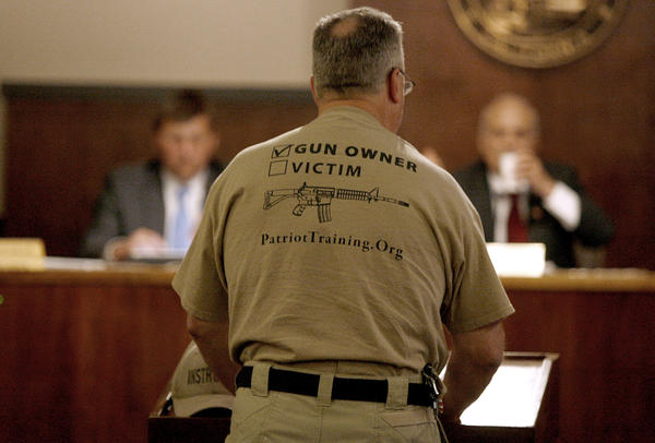 A pro-gun advocate addresses the Glendale City Council on Tuesday. The council directed the city attorney to draft an ordinance to ban the sale of guns on city-owned property.