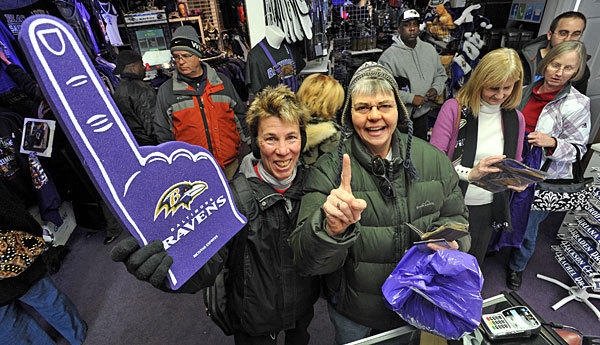 Mary Cupo of Parkville, left, and Mary Sue Bride of Glen Arm stock up on fresh Ravens merchandise.