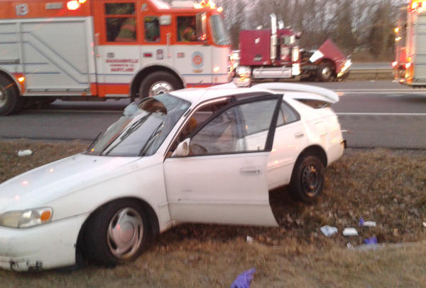 The driver of this Toyota Corolla was taken to Meritus Medical Center after a crash with a tractor-trailer (at center, in background) on Interstate 81 near Halfway Boulevard on Wednesday morning.