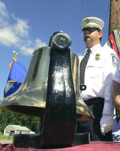 In this 2002 file photo, John Fleagle, representing the Blue Ridge (Pa.) Fire Department, takes part in a 9/11 remembrance ceremony at Cascade (Md.) American Legion. Police say Fleagle, who also was a former police officer in Waynesboro and Washington Township, Pa., shot and killed his wife and wounded his stepson before taking his own life at their Rouzerville, Pa., home on Jan. 22, 2013.