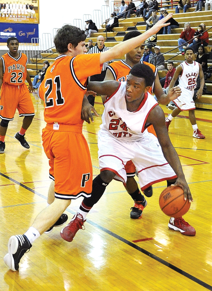 George Rogers Clark forward Khamarkis Blanton dribbles around a Paris defender in the Cardinals 70-47 rout of the Greyhounds Tuesday night at Norton Gymnasium. The win snapped Clarks five-game losing streak.