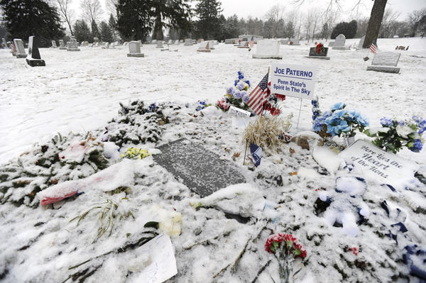 A snow covered Joe Paterno gravesite is seen at the Spring Creek Presbyterian Cemetery, in State College, Pennsylvania, Monday, January 21, 2013. Tuesday, January 22, 2013 marks the one-year anniversary of Joe Paterno's death.