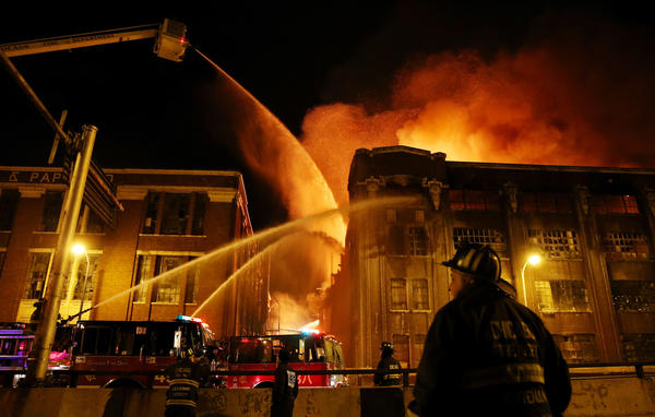 Firefighters battle a 5-11 blaze at 3757 South Ashland Ave. in the Bridgeport neighborhood of Chicago.