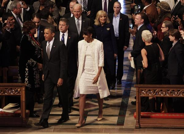 First Lady Michelle Obama wears an ivory ensemble by Naeem Khan as she accompanies her husband President Obama on the National Day of Prayer.