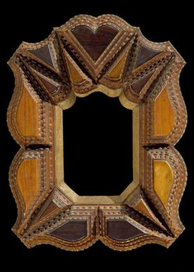 This circa 1900 picture frame features a central heart and other geometric figures.