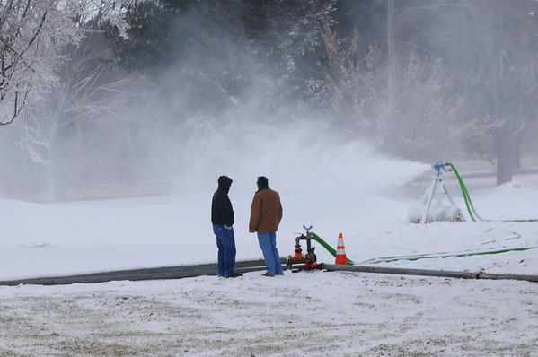 SIMSBURY--1/22/13--From left, CL&P's Jim Millspaugh Jr., and Andrew J. Ouellette watch the snow guns at work Tuesday in preparation for the Special Olympics Connecticut Winter Games Cross-Country Skiing and Snowshoeing Competition coming up in March at CL&P's Simsbury Area Work Center, 34 Hopmeadow St., Simsbury. Snow making began Monday at 6 a.m. and will go on non-stop for 96 hours through through Thursday, Quellette said.That will amount to 750,000 gallons of water,  Mitch Gross, CL&P spokesman, added. Every year since 1991, a  group of snowmaking volunteers, primarily Northeast Utilities employees and retirees, has been making the snow happen. Ouellette, who is in charge of the snow making operation,  said that a crew of 15, mostly Northeast Utilities retirees, (parent company of Cl&P) is working on the snow making this year.