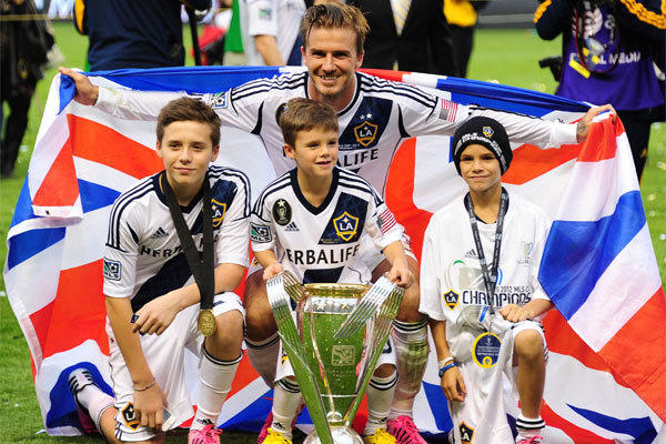 David Beckham poses with sons Brooklyn, left, Cruz and Romeo after the Galaxy claimed the MLS Cup in December.