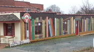 Circle City Books in Pittsboro, N.C., has just completed an eye-catching mural: a side of a building covered in books. Huge, oversize books, with titles that even this myopic passerby could read.