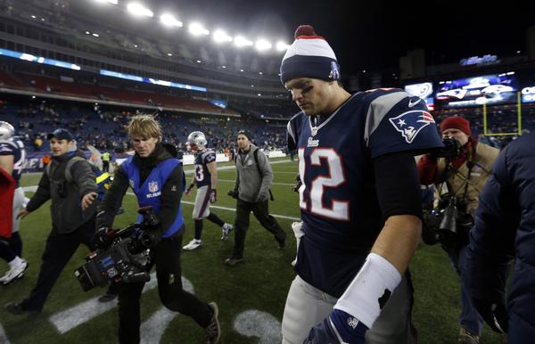 New England Patriots quarterback Tom Brady walks off the field after losing the AFC championship game. The Patriots lost last year's Super Bowl to the New York Giants.