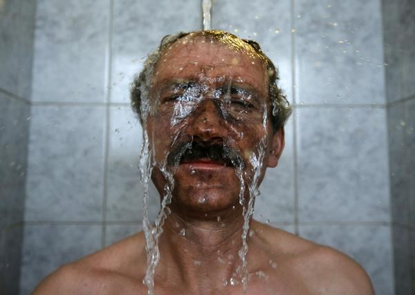 A miner takes a shower after his shift in Hungary's last remaining deep-cast coal mine at Markushegy.