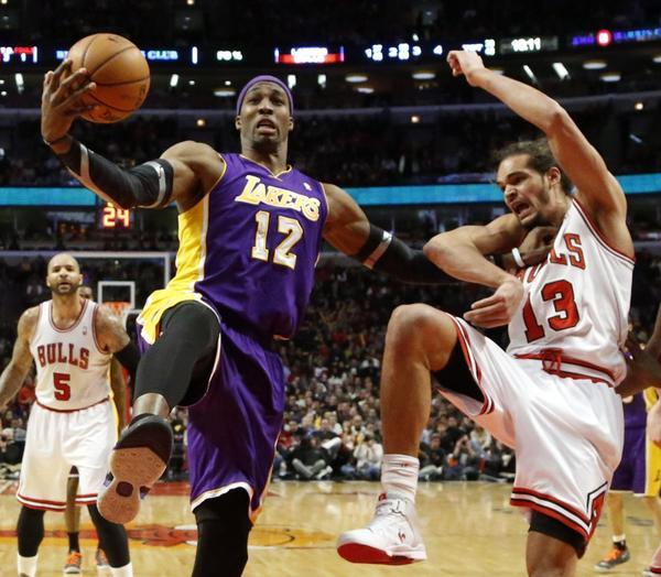 Dwight Howard, shown battling Chicago's Joakim Noah on Monday, apologized for complaining about his number of touches after the Lakers' loss to the Bulls.