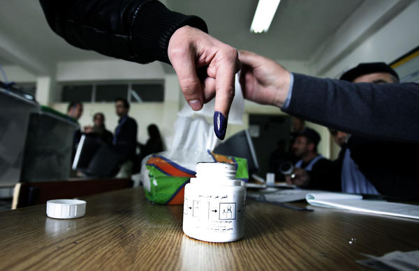 A Jordanian man inks his finger after casting his vote inside a polling station in Amman on Wednesday.