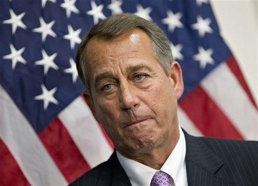 House Speaker John Boehner, R-Ohio, talks to reporters after a long closed-door meeting Tuesday on a strategy to deal with a potential debt crisis.