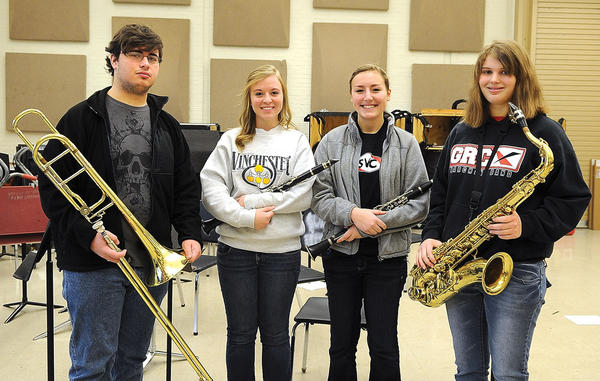 Four George Rogers Clark High School band students have been recognized for making the Kentucky Music Educators Association All District Band and All State Band. Making All District Band are, from left, Mark Vance II, Kristen Wade, Katie Long and Brittany Conn. Long also made the All State Band. Students must audition for both bands, competing against student musicians in Fayette and surrounding counties. The All District Band will perform Saturday at Bryan Station High School in Lexington. The All State Band concert will be at 3 p.m. on Feb. 9 in Louisville. The GRCHS band is directed by Chris Yoo.