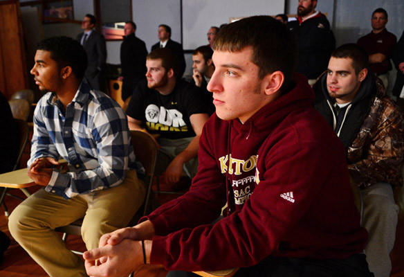 Kutztown football team members including quarterback Josh Luckenbaugh, foreground, listen as new Kutztown University head football coach Drew Folmar is introduced. This is during a press conference at Kutztown University Wednesday.