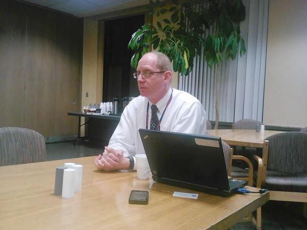 OPRF Assistant Superintendent Philip Prale talks with parents Tuesday at a forum at the school.