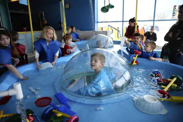 Jake Schmeiser, 7, of Bolingbrook, is in the middle of the action at DuPage Children's Museum in Naperville.