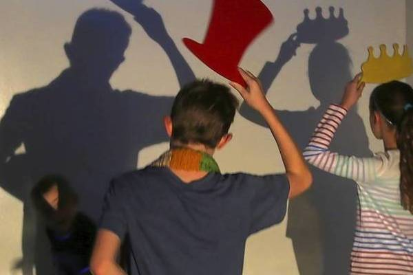 Children enjoy their shadows at DuPage Children's Museum in Naperville.