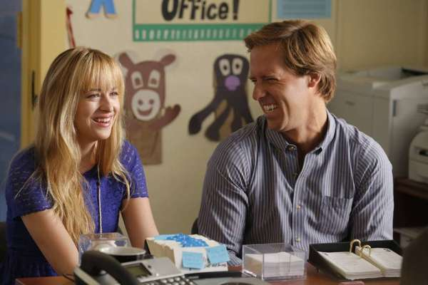"Nat Faxon, as Ben, right, and Dakota Johnson, as Kate, in a scene from ""Ben and Kate."""