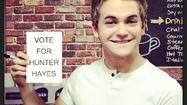 "<span style=""font-size: small;"">Hunter Hayes is playing out one of his favorite action figures in hopes for a few ACM New Male Vocalist votes. The singer is up against Lee Brice and Brantley Gilbert for the fan voted award, and Hunter thought it was a perfect fit to act out a ""James Bond"" montage.</span>"